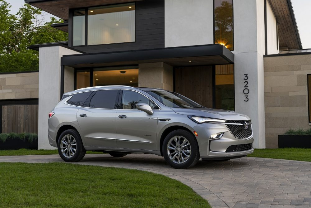 Front side view of 2022 Buick Enclave parked in front of house