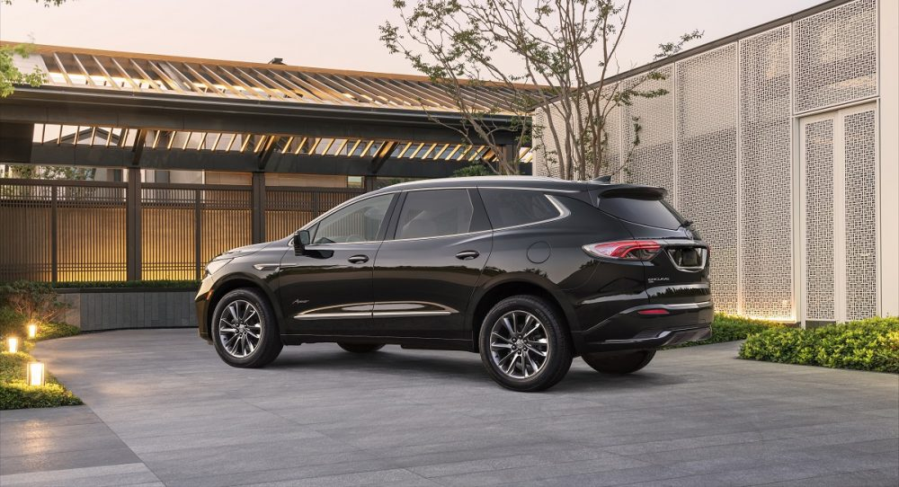 Rear side view of 2022 Buick Enclave parked in driveway