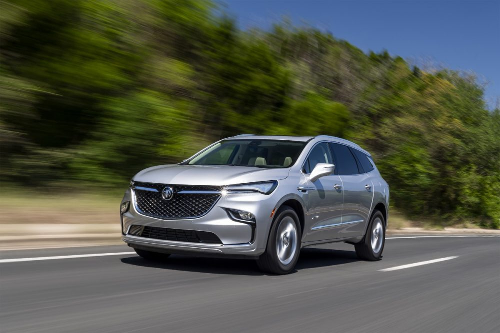 Front side view of 2022 Buick Enclave driving down road