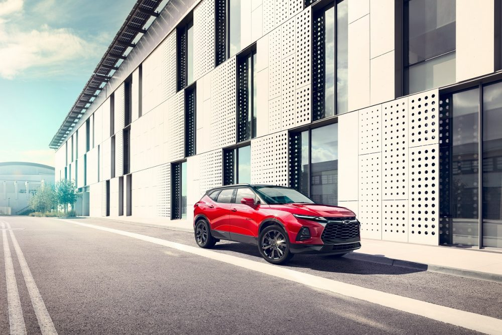 The Front side view of red 2022 Chevrolet Blazer RS parked on street
