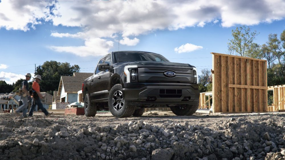 2022 Ford F-150 Lightning Pro parked at a job site
