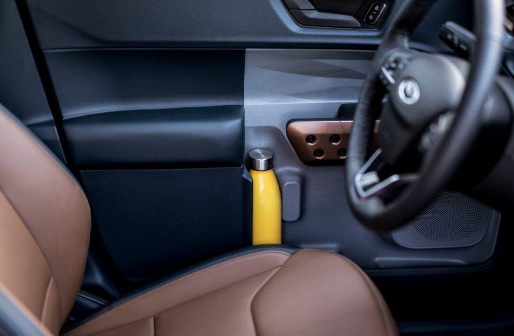 2022 Ford Maverick Lariat with 2.0-liter EcoBoost AWD Desert Brown interior with ActiveX front bucket seats in-door storage