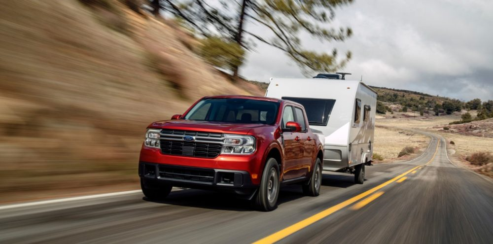 2022 Ford Maverick Lariat with 2.0-liter EcoBoost AWD in Hot Pepper Red towing a camper