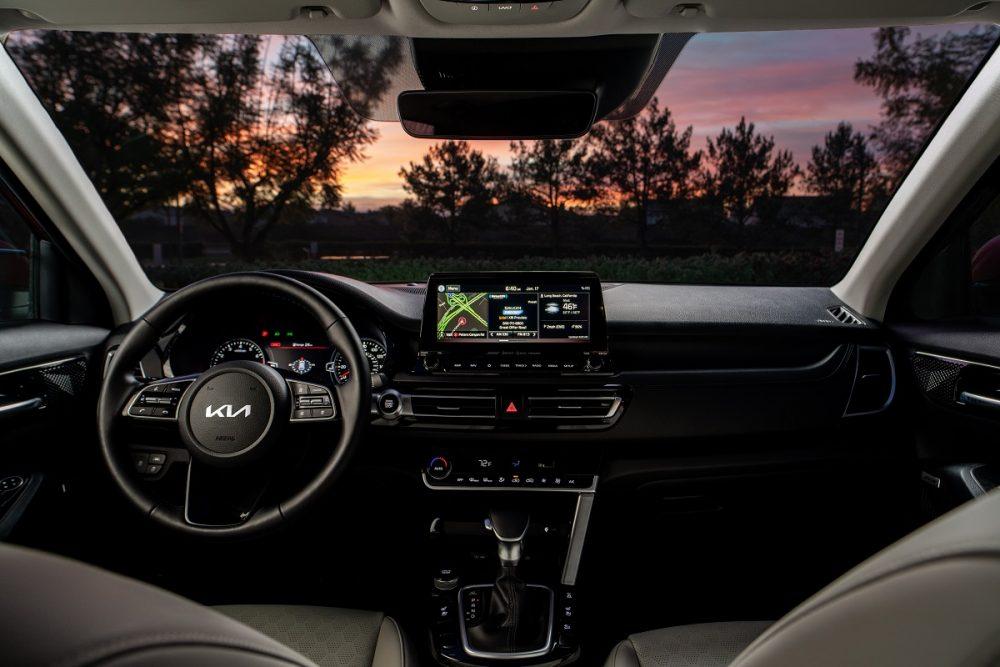 Nighttime photo of 2022 Kia Seltos SX Turbo interior dashboard and steering wheel