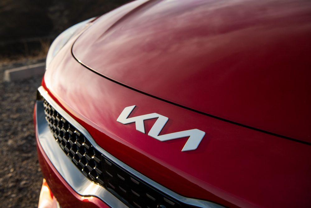 Close up photo of a red 2022 Kia Stinger logo on its hood