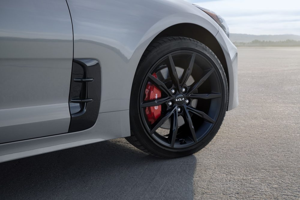 Close up view of 19-inch black wheels on the 2022 Kia Stinger Scorpion Special Edition in Ceramic Silver