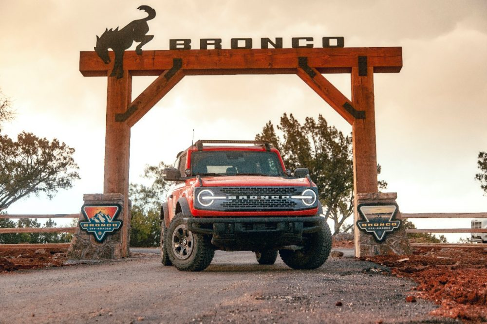 A Ford Bronco sitting under the entrance gate to the Bronco Off-Roadeo in Horseshoe Bay outside of Austin, Texas