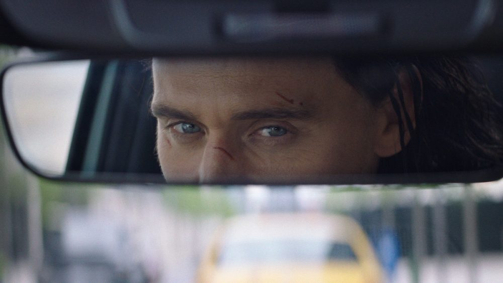 Ad still: Loki's eyes are reflected in 2022 Hyundai Tucson rearview mirror