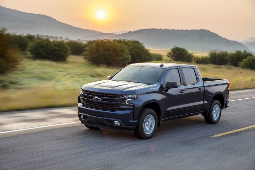 Front side view of 2021 Chevrolet Silverado 1500 RST driving down road