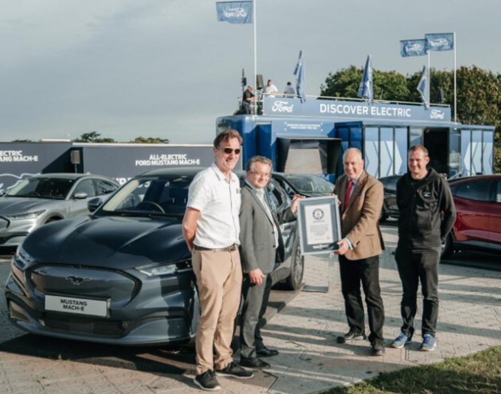 Representatives from Ford and Guinness World Records commemorate the Mustang Mach-E setting a record for least energy consumed by an electric vehicle