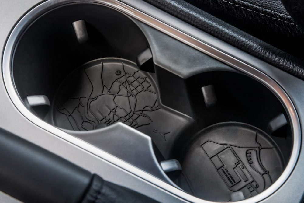Close up of the 2022 Volkswagen Passat Limited Edition cup holders with aerial map designs