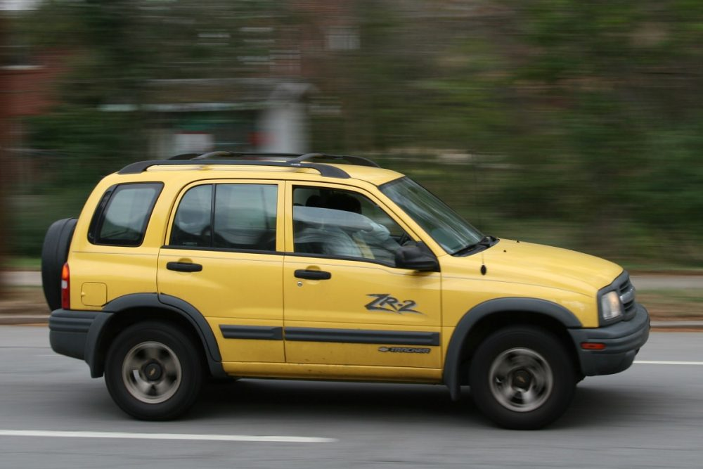 A yellow Chevrolet Tracker ZR2 cruises on a street