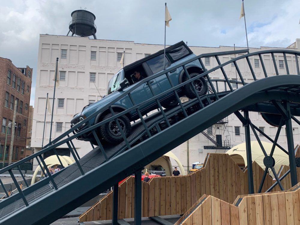 A 2021 Ford Bronco tackling a 38-degree decline at the Built Wild Bronco mountain experience at the 2021 Chicago Auto Show