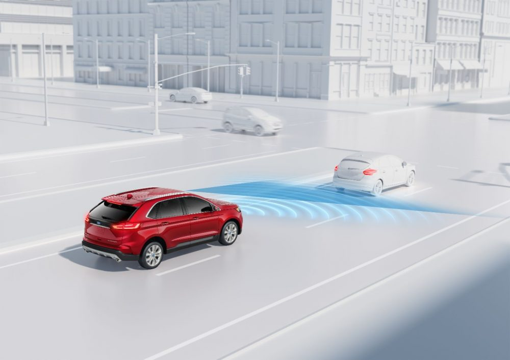 A graphic depicting a red Ford Edge demonstrating the Automatic Emergency Braking with Pre-Collision Assist feature offered in Ford Co-Pilot360