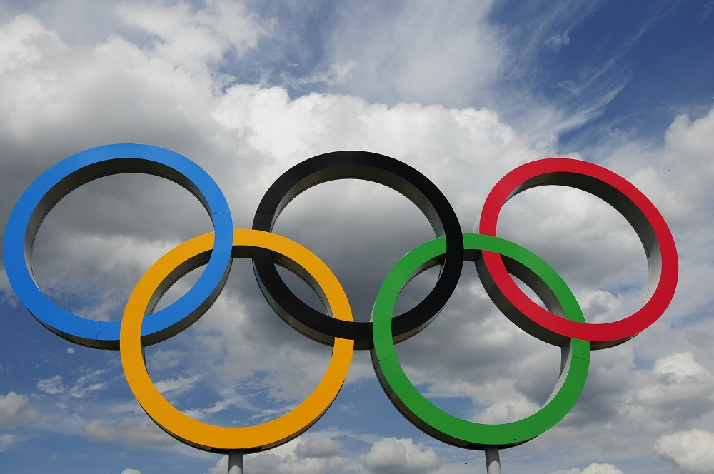 Olympic rings with cloudy sky background
