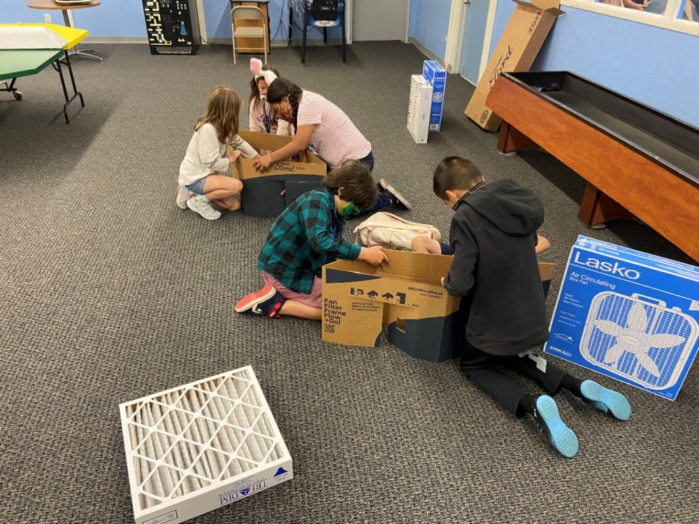 Kids at the Boys and Girls Club South Coast Area constructing a Ford Scrappy Filtration kit
