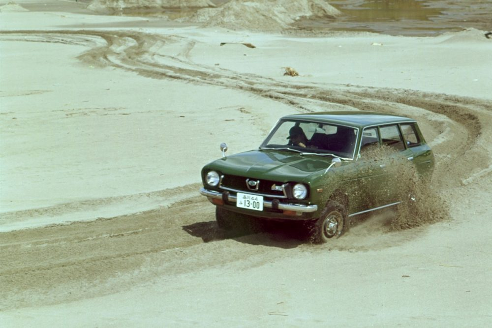 An old photo of the Subaru Leone wagon driving on sand from the 1970s