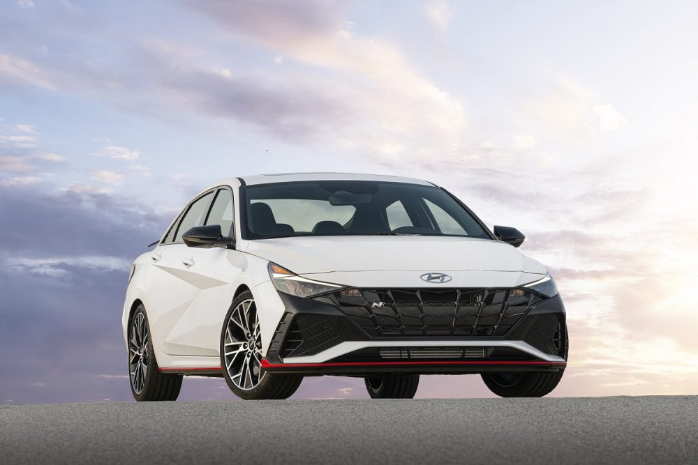 Front side view of parked white 2022 Hyundai Elantra N