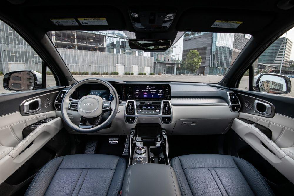 Interior view of the 2022 Kia Sorento PHEV, showcasing the dash, steering wheel, and front seats