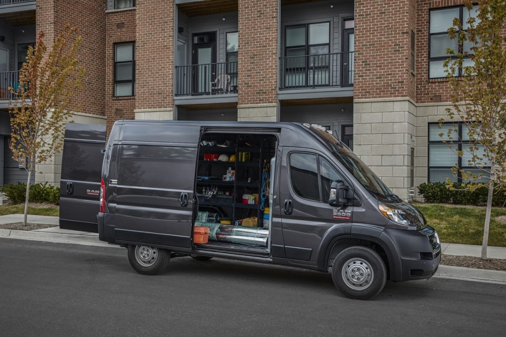 The 2022 Ram ProMaster 3500 parked on the street with a side door open