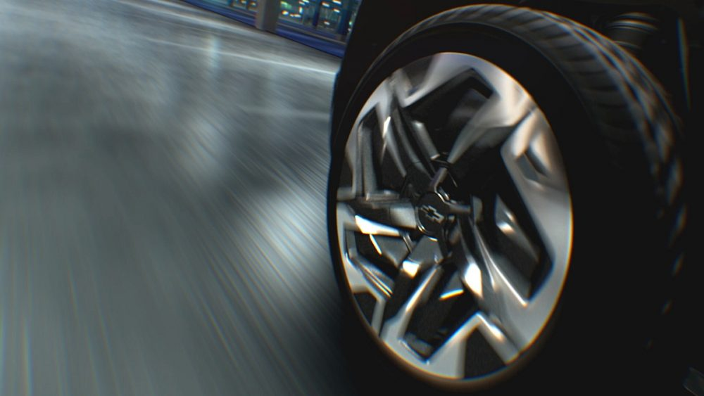 Close-up of electric Chevrolet Silverado's 24-inch wheels during Four-Wheel Steer maneuver