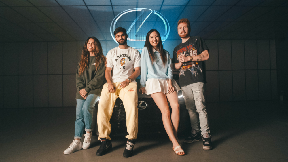 100 Thieves content creators in front of the Lexus IS