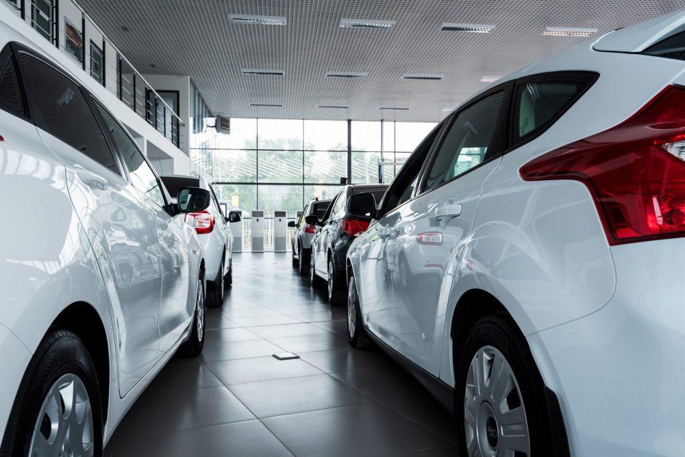 new cars on display inside a car dealership
