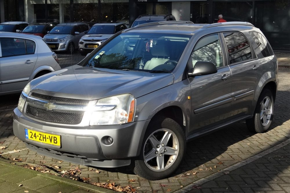 A silver gray 2008 Chevrolet Equinox is parked somewhere in Europe
