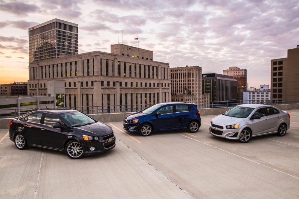 Three 2016 Chevrolet Sonic models parked in a city