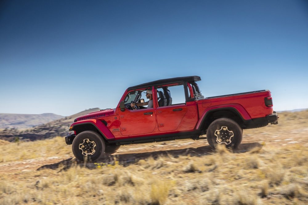 The 2021 Jeep Gladiator with half doors driving in a desert landscape