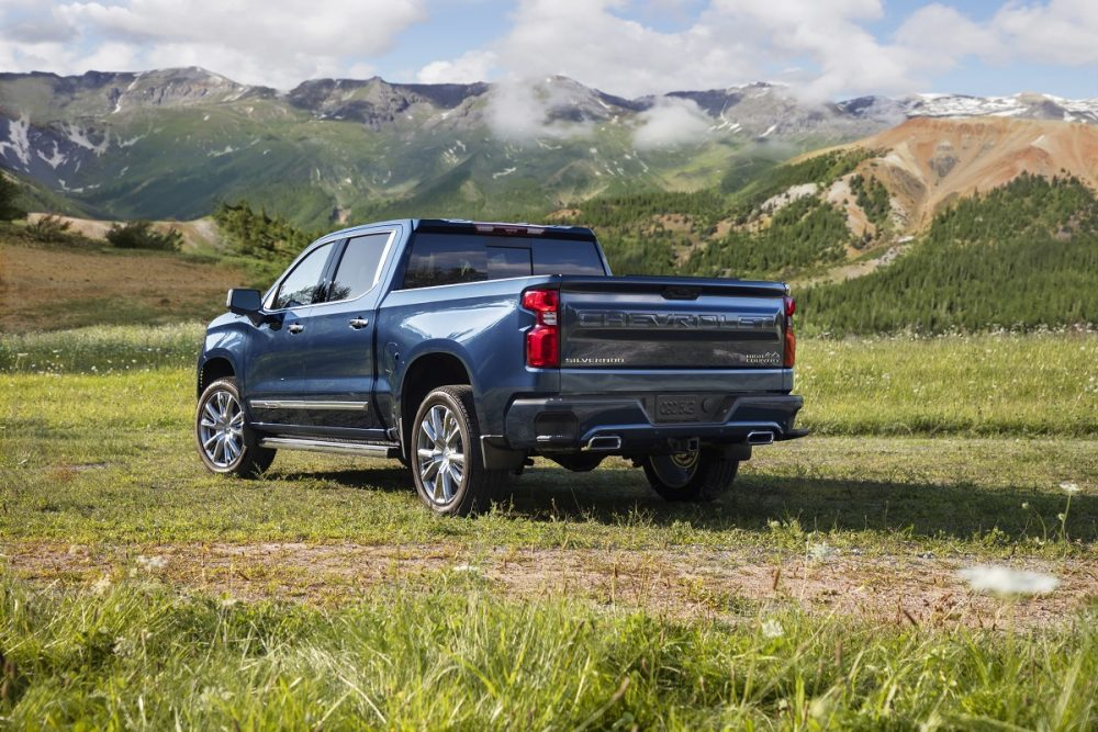 Rear side view of 2022 Chevrolet Silverado 1500 High Country with mountains in background