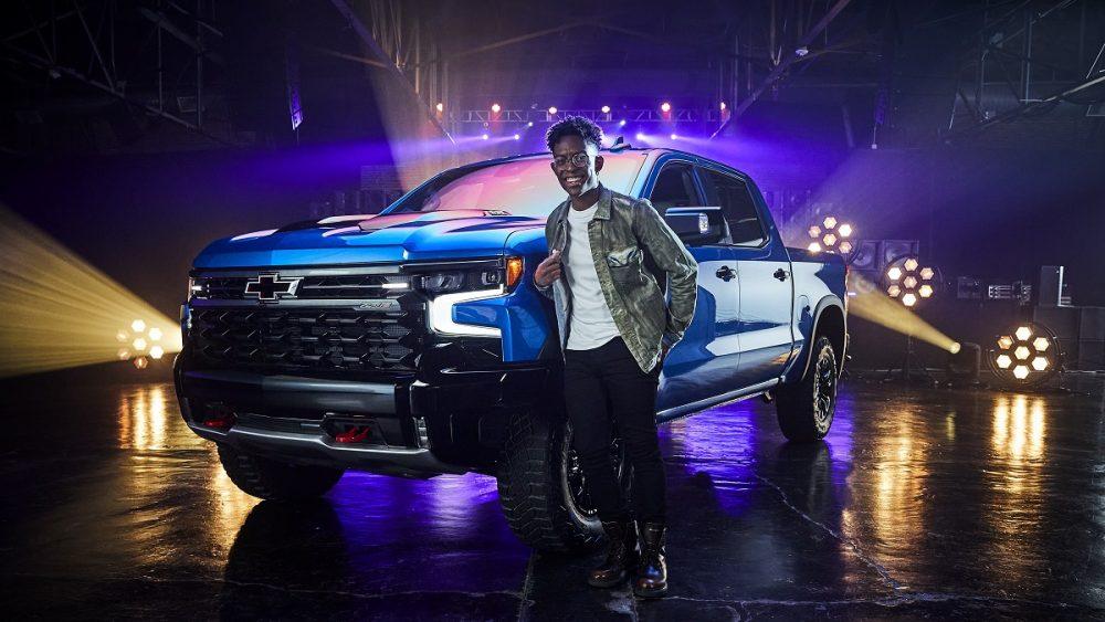 The musician BRELAND poses in front of the 2022 Chevrolet Silverado 1500 ZR2
