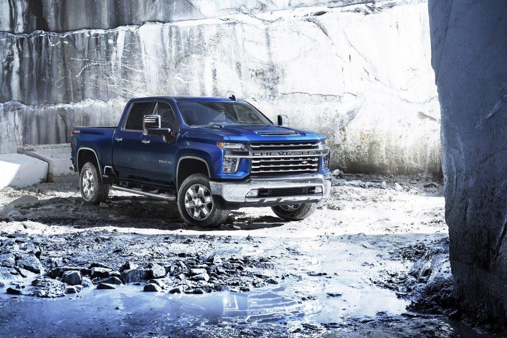 A blue 2022 Chevrolet Silverado 2500HD is parked in a rocky area