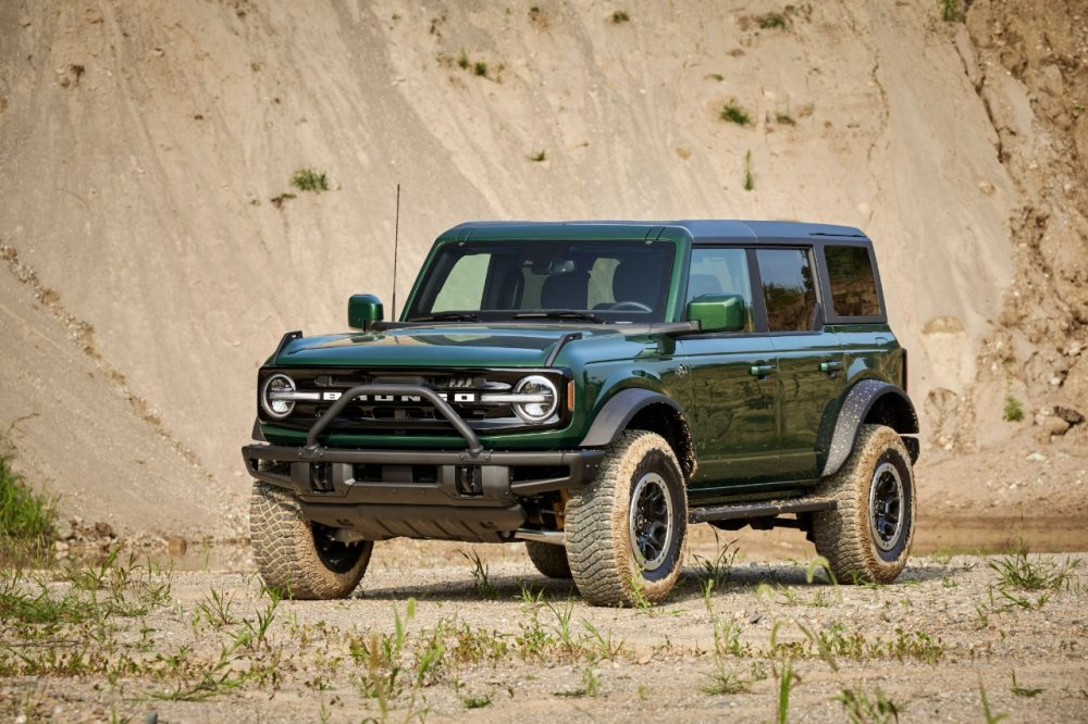 Front left quarter angle of 2022 Ford Bronco four-door in Eruption Green