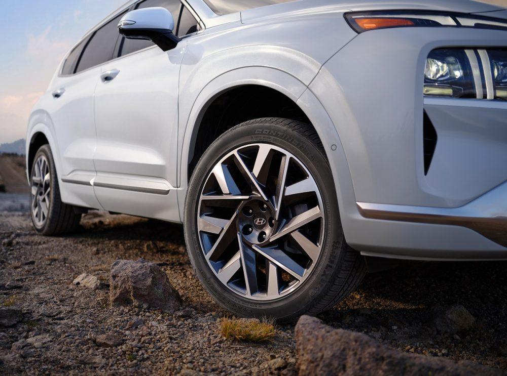 Close-up view of white 2022 Hyundai Santa Fe front wheel
