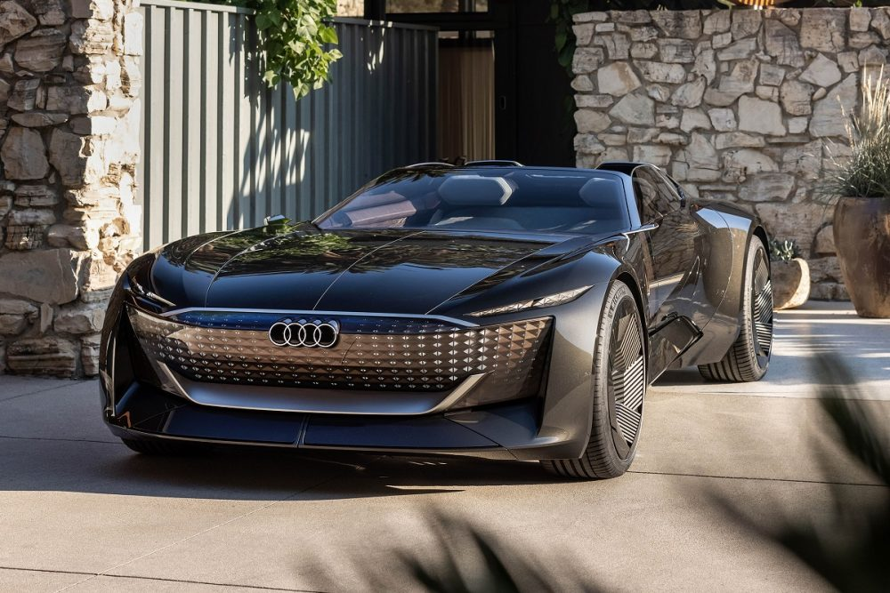 Front view of a black Audi skysphere concept parked at sunset in front of a home in a residential area