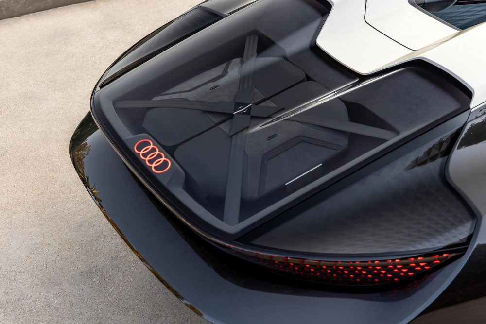 Aerial view of the rear of a black Audi skysphere concept, showing off the glass cargo area and LED logo