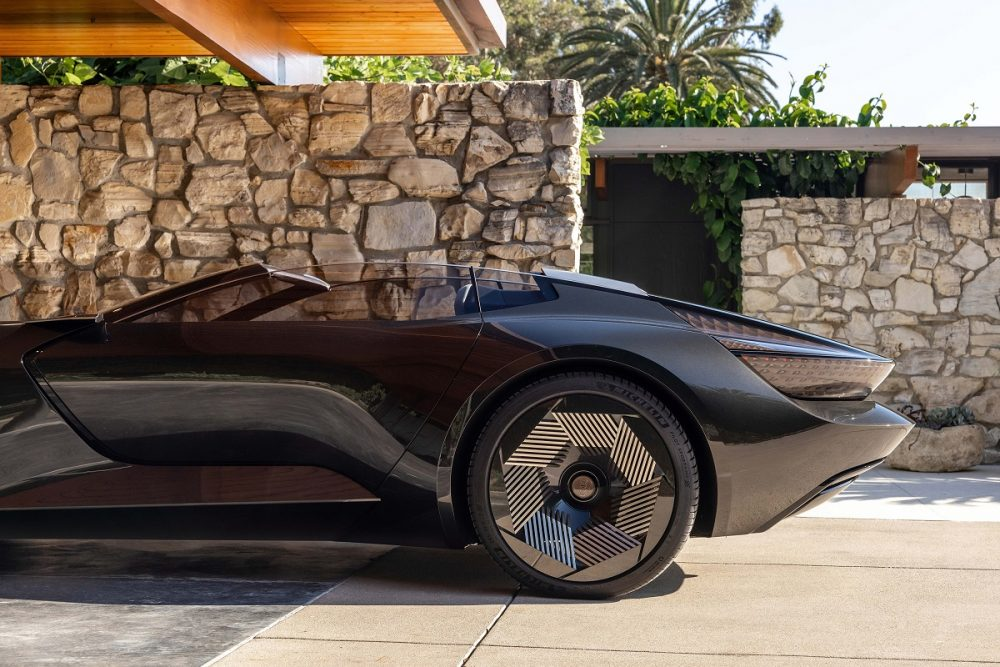 Side view of the rear of a black Audi skysphere concept parked at sunset in a residential area