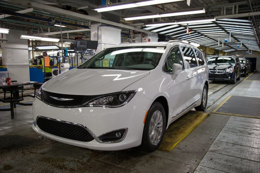 A Chrysler Pacifica at the Windsor Assembly Plant with more Pacificas in line behind it