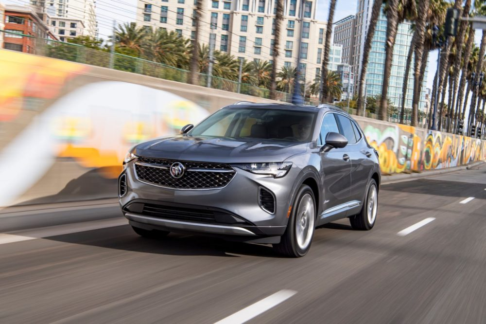 2022 Buick Envision driving down a city street