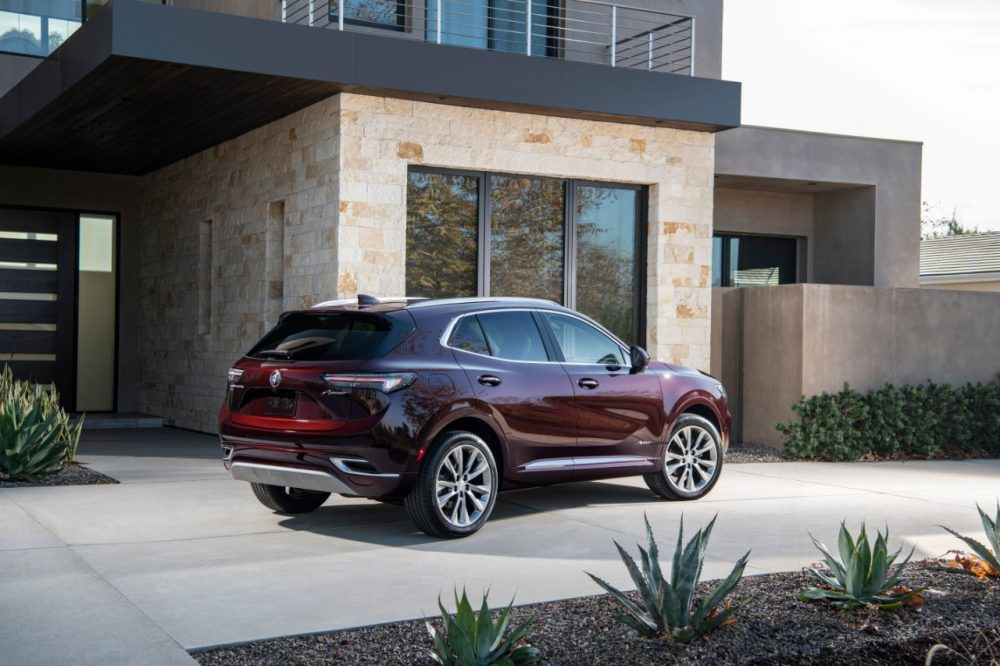 2022 Buick Envision parked in front of a stone building