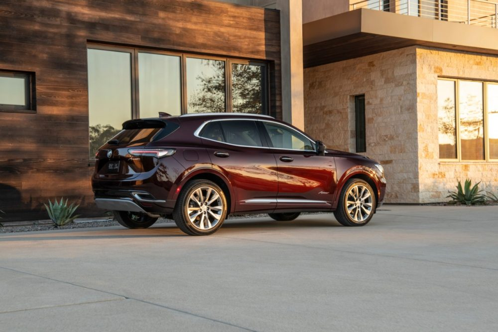 2022 Buick Envision parked in front of a building with reflective windows