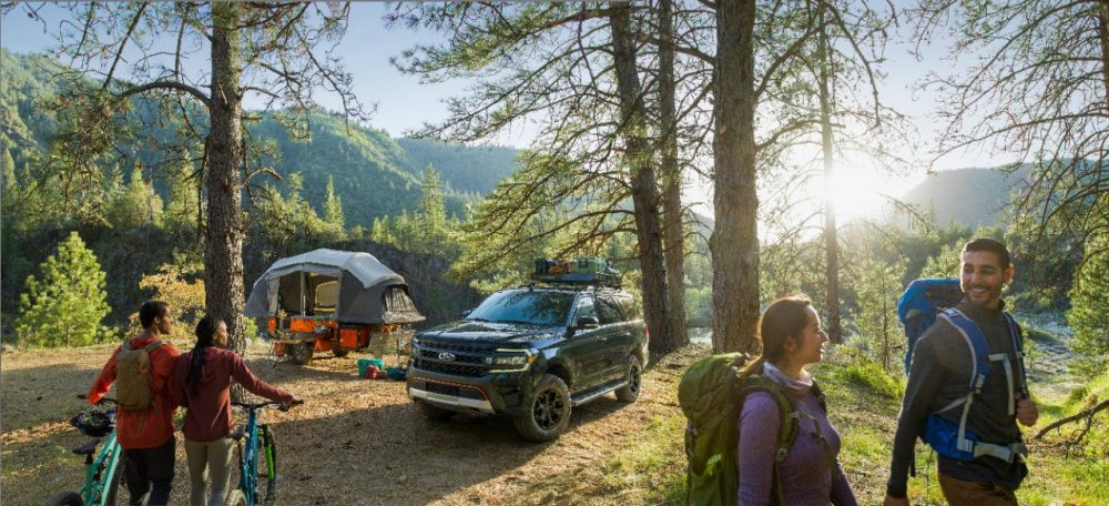 2022 Ford Expedition Timberline in a clearing with campers