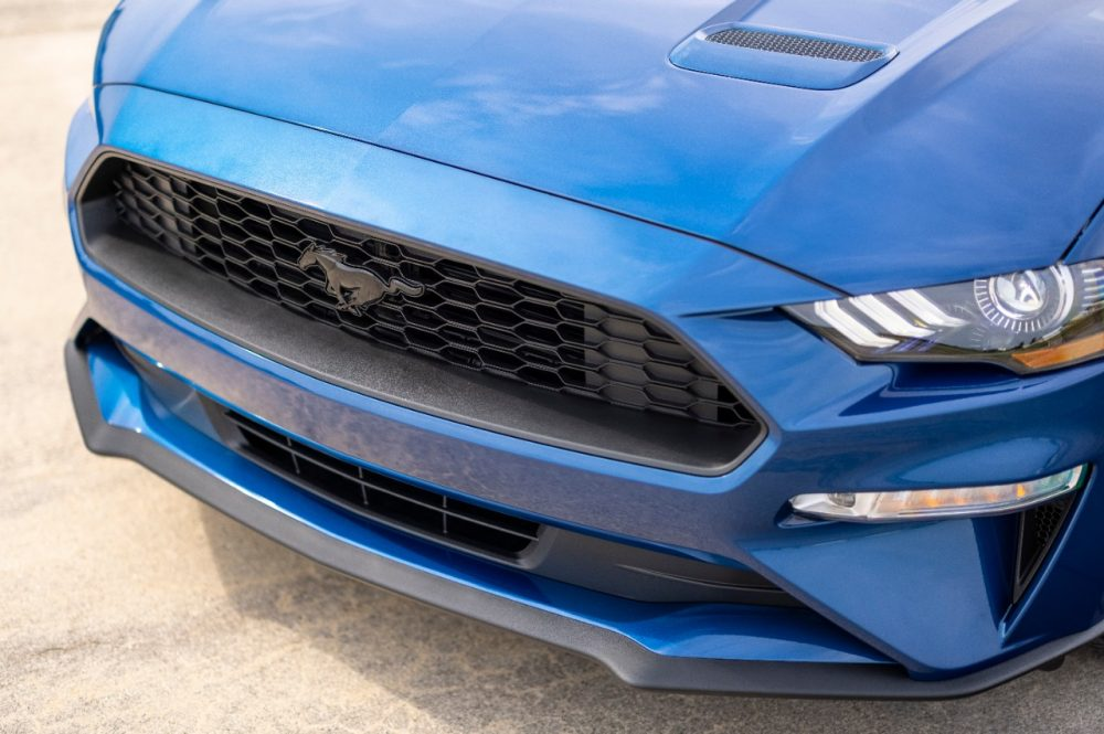 2022 Ford Mustang Stealth Edition in Atlas Blue honeycomb grille with black pony emblem