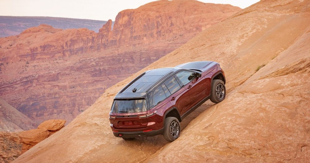 2022 Jeep Grand Cherokee Trailhawk going up a steep incline