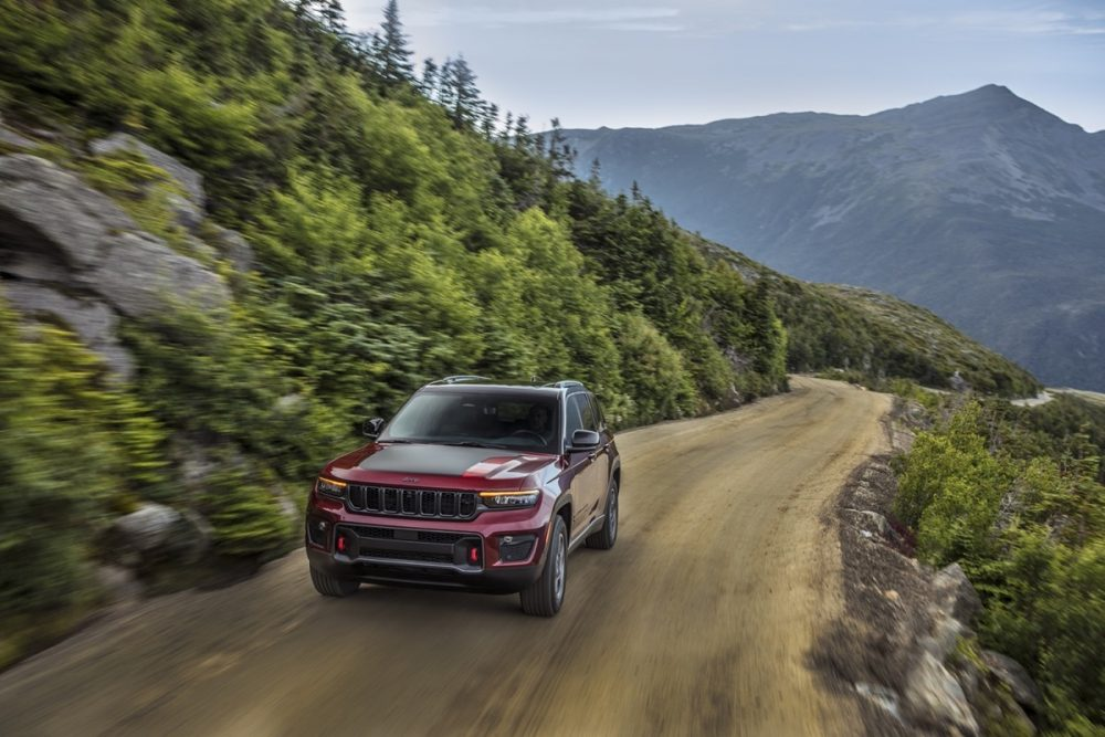 The 2022 Jeep Grand Cherokee Trailhawk driving on a sandy road