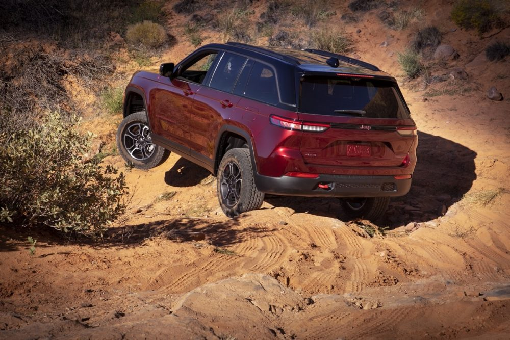 The 2022 Jeep Grand Cherokee Trailhawk driving on sand