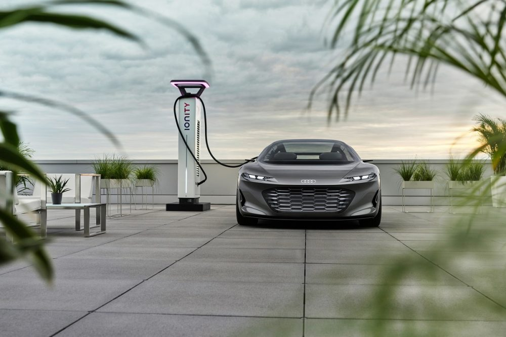 Front view of the Audi grandsphere concept at a charging station