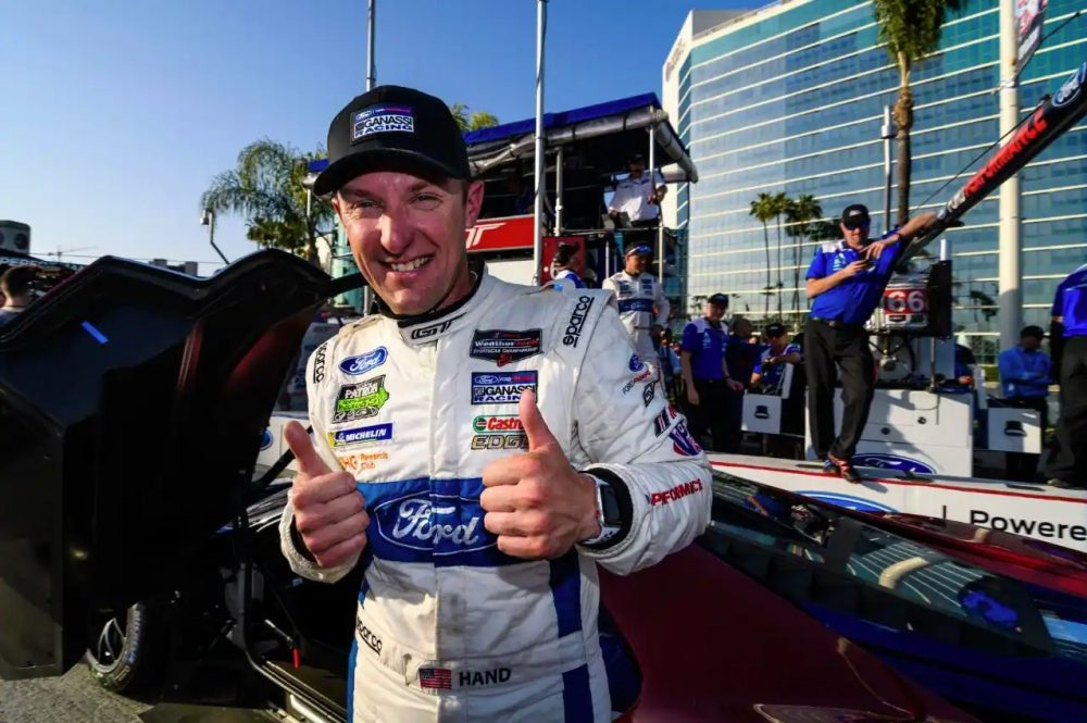 Joey Hand Ford Performance Motorsport Giving Thumbs Up Near a Ford GT